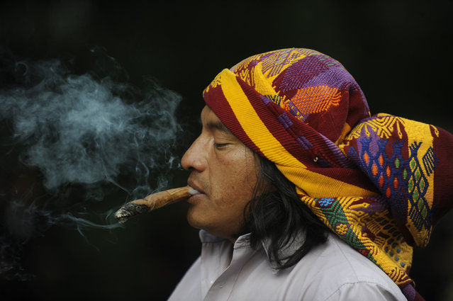"A Mayan shaman performs a ritual at the Quirigua archaeological site, Izabal department, 210 km north of Guatemala City. Ceremonies will be held here to celebrate the end of the Mayan cycle known as Bak'tun 13 and the start of the new Maya Era on December 21. The Mayan calendar has 18 months of 20 days each plus a sacred month, ""Wayeb"", with five days. ""B'aktun"" is the largest unit in the time-cycle system, and is about 400 years. The broader era spans 13 B'aktun, or about 5,200 years. (Photo by Johan Ordonez)"