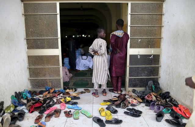 Slippers are seen at the entrance of the Kofar Mata central mosque during prayers to mark the Muslim festival of Eid al-Adha festival in the city of Kano, Nigeria, September 24, 2015. (Photo by Akintunde Akinleye/Reuters)