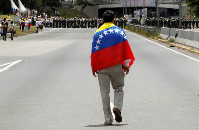 An opposition supporter takes part in a rally to demand a referendum to remove Venezuela's President Nicolas Maduro, in Caracas, Venezuela, September 1, 2016. (Photo by Christian Veron/Reuters)