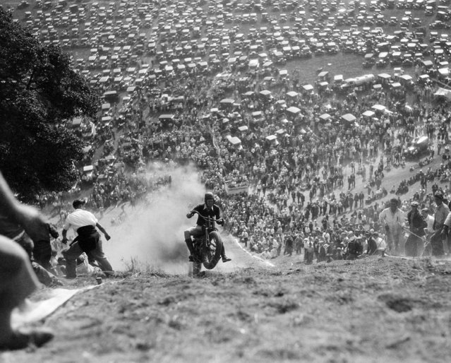 Topping a hill of 70 percent grade near Oakland, Calif., October 18, 1931, Windy Lindstrom of Oakland rode into the 1931 National Professional Championship for Motorcycles of 61-cubic inch displacement. Lindstrom placed second in the 45-inch class. (Photo by AP Photo)