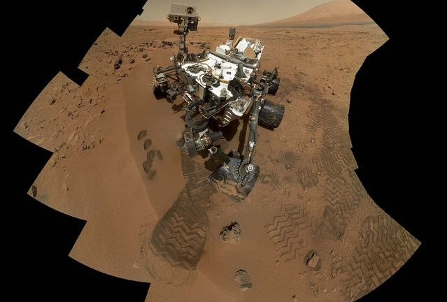 This image shows the work site of the NASA rover Curiosity on Mars, December 3, 2012. Results are in from the first test of Martian soil by the rover Curiosity: So far, there is no definitive evidence that the red planet has the chemical ingredients to support life. Scientists said that a scoop of sandy soil analyzed by the rover's chemistry lab contained water and a mix of chemicals, but not the complex carbon-based compounds considered necessary for microbial life. (Photo by NASA)