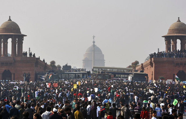 Protesters gather outside the Presidential Palace in New Delhi, on December 22, 2012. Police in India's capital used tear gas and water cannons to push back thousands of people who tried to march to the presidential mansion. (Photo by Tsering Topgyal/AP Photo)