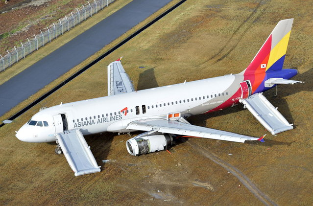 An aerial view shows an Asiana Airlines airplane which ran out of runway after landing at Hiroshima airport in Mihara, Hiroshima prefecture, western Japan, in this photo taken by Kyodo April 15, 2015. An investigation has been launched after the Asiana Airlines passenger jet skidded off the runway after landing at Japan's Hiroshima airport on Tuesday, local media reported. The Airbus A320 jet was arriving from the South Korean capital of Seoul when it ran off the runway and slid onto an embankment shortly after 8pm local time (1100 GMT). (Photo by Kyodo News via Reuters)