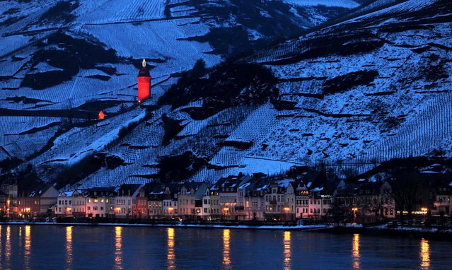 The former tower of the city wall is decorated as a candle in Zell an der Mosel, Germany. (Photo by Harald Tittel/Dapd/Associated Press)