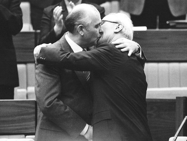 Then Soviet Leader Mikhail Gorbachev congratulates the East German Leader Erich Honecker with a fraternal hug and kiss after Honecker's re-election as General Secretary of the Communist Party Congress in East Berlin, April 21, 1986. (Photo by Reuters)
