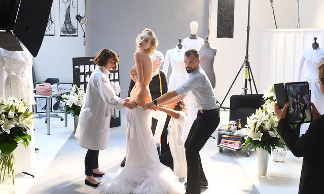French fashion designer Julien Fournie (R) poses with his Czech model Michaela Tomanova during the shooting of a film designed in place of the fashion show on June 30, 2020 as France eases lockdown measures taken to curb the spread of the COVID-19 disease caused by the novel coronavirus. (Photo by Franck Fife/AFP Photo)