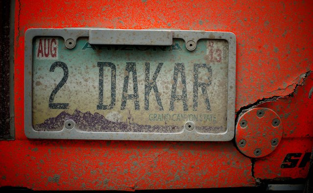 Robby Gordon's vehicle displays a personalized license plate on the back of his Hummer, parked at the Dakar Rally encampment in Salta, Argentina, at the end of the 7th stage on Friday, January 11. (Photo by Victor R. Caivano/Associated Press)