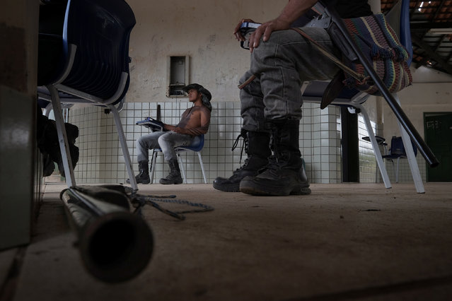 Francisco Neto Guajajara, 24 and other members of the Guardians of the Forest hang out in a school building in Araribóia Indigenous Reserve, Maranhão, Brazil on August 7, 2015. (Photo by Bonnie Jo Mount/The Washington Post)