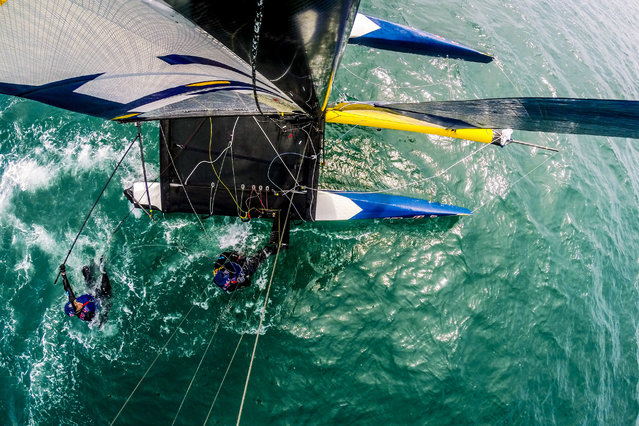 Participants perform during Red Bull Foiling Generation in Weymouth, United Kingdom. (Photo by Red Bull/SWNS.com)