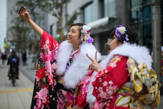 Women wearing kimonos take a selfie attending a Coming of Age ceremony on January 8, 2018 in Yokohama, Japan. (Photo by Carl Court/Getty Images)