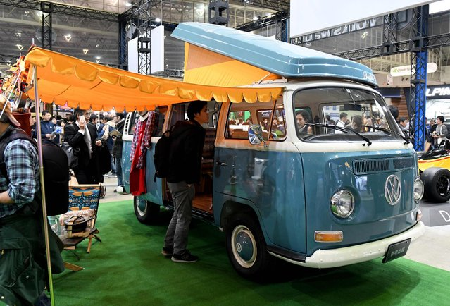 A classic Volkswagen camper is displayed at the Volkswagen booth of the Tokyo Auto Salon at the Makuhari Messe in Chiba on January 12, 2018. (Photo by Toshifumi Kitamura/AFP Photo)