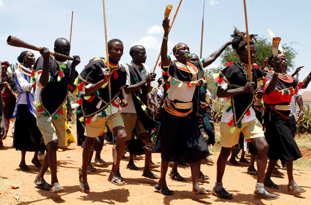 Pokot community traditional dancers perfom during a graduation for the girls who escaped from Female Genital Mutilation and forced early marriages ceremony after completing trainings on social entrepreneurship and information and communications technology (ICT) at the St. Elizabeth girls centre in Ortum, West Pokot county, Kenya, September 15, 2016. (Photo by Reuters/Stringer)