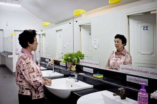 "Thailand. Sineha, 71, uses a public toilet which is inside the temple she visits. ""They are convenient and cleaned daily by the maid. It is a safe place because we have security guards here 24 hours a day and separate toilets for men and women"". (Photo by Patrick Brown/WSUP/Panos)"