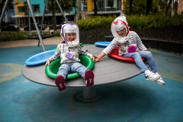Children are seen with helmets similar to the ones used by astronauts, which have designed by a group of Colombian engineers to be employed as a protective bubble against the novel coronavirus (COVID-19) pandemic in Bogota, Colombia on October 12, 2020. The helmet weighs 650 grams (22.9 oz) and consists of a plastic structure, an electrical part, filters, and a lithium battery with a duration of approximately 6 hours. Currently, they have a version for children, which seek to have greater protection with the return to school and abroad, making the bubble an attractive product to children with comfort and that it is a pleasure to use it since they look like superheroes or astronauts. (Photo by Juancho Torres/Anadolu Agency via Getty Images)