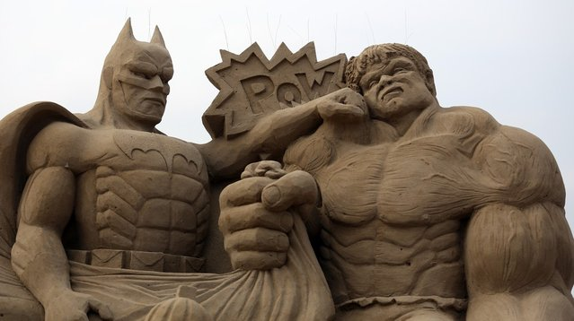 Detail of a sand sculpture of Batman and The Incredible Hulk is seen as pieces are prepared as part of this year's Hollywood themed annual Weston-super-Mare Sand Sculpture festival on March 26, 2013 in Weston-Super-Mare, England. Due to open on Good Friday, currently twenty award winning sand sculptors from across the globe are working to create sand sculptures including Harry Potter, Marilyn Monroe and characters from the Star Wars films as part of the town's very own movie themed festival on the beach.  (Photo by Matt Cardy)