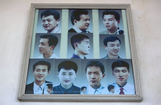 Photos showing example hair styles hang inside a barber shop in Pyongyang, North Korea on Wednesday, February 20, 2013. (Photo by David Guttenfelder/AP Photo)