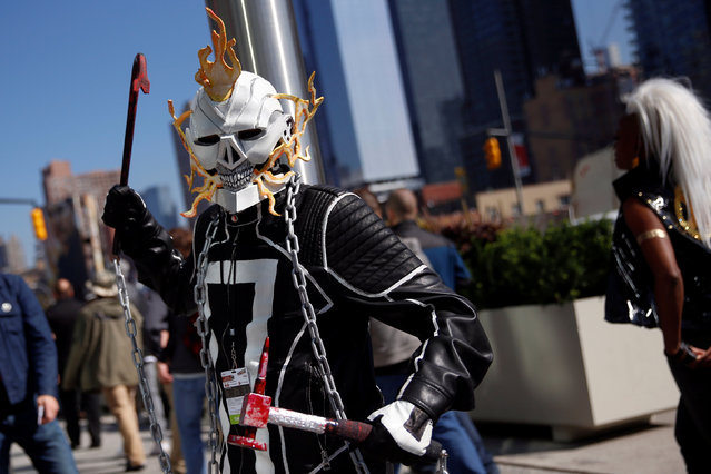 A man dressed in costume poses outside the New York Comic Con in New York, U.S., October 6, 2016. (Photo by Shannon Stapleton/Reuters)