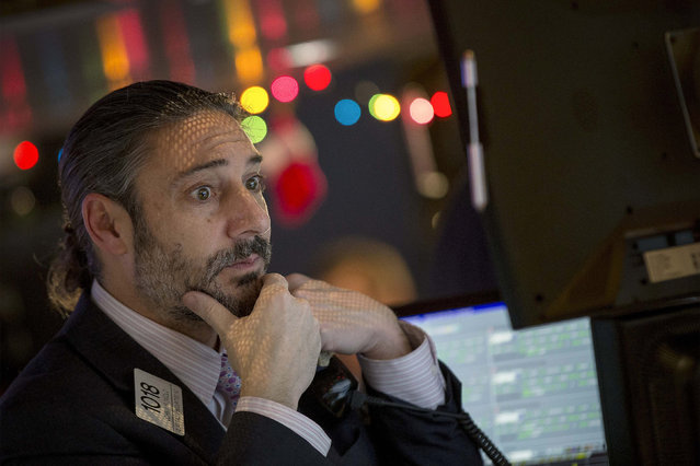 A trader works on the floor of the New York Stock Exchange December 15, 2014. (Photo by Brendan McDermid/Reuters)