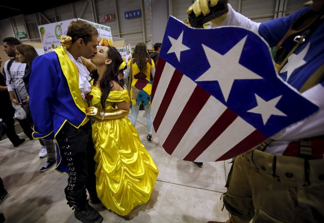 Participants wearing heroic fantasy costumes kiss during the second edition of the Hero Festival in Marseille, France November 7, 2015. (Photo by Jean-Paul Pelissier/Reuters)