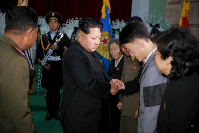 North Korean leader Kim Jong Un shakes hands with mourners during the funeral of the late Korean People's Army general Lee Ul Sol November 8, 2015 in this photo released by North Korea's Korean Central News Agency (KCNA) in Pyongyang on November 9, 2015. (Photo by Reuters/KCNA)
