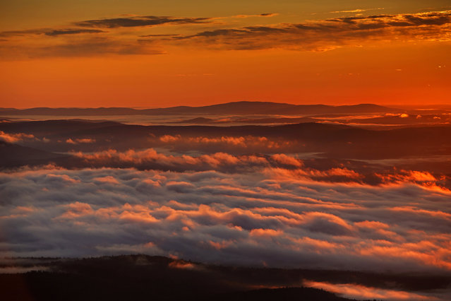 Valley fog, caused by cool air flowing over moist land, drifts across Oxford County in this view at dawn looking east over Lovell, Maine, Friday, September 8, 2017. (Photo by Robert F. Bukaty/AP Photo)