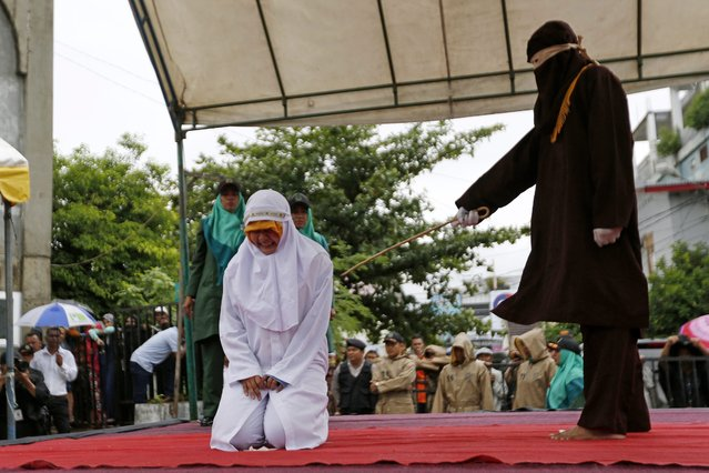 An Acehnese woman is being whipped in front of the public at Baiturrahman Grand Mosque, Banda Aceh, Indonesia, 17 October 2016. (Photo by Hotli Simanjuntak/EPA)