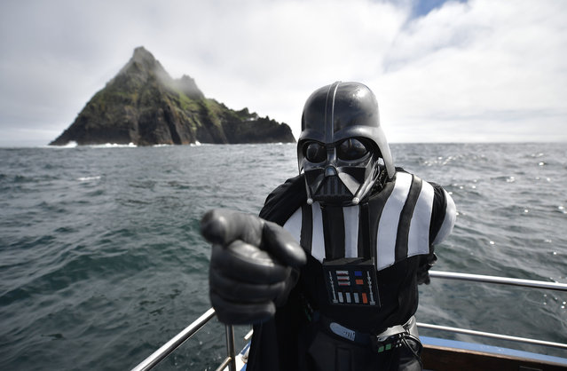 A Star Wars fan dressed as the character Darth Vader takes a boat trip to the Skelligs on International Star Wars day May 4, 2018 in Portmagee, Ireland. (Photo by Charles McQuillan/Getty Images)