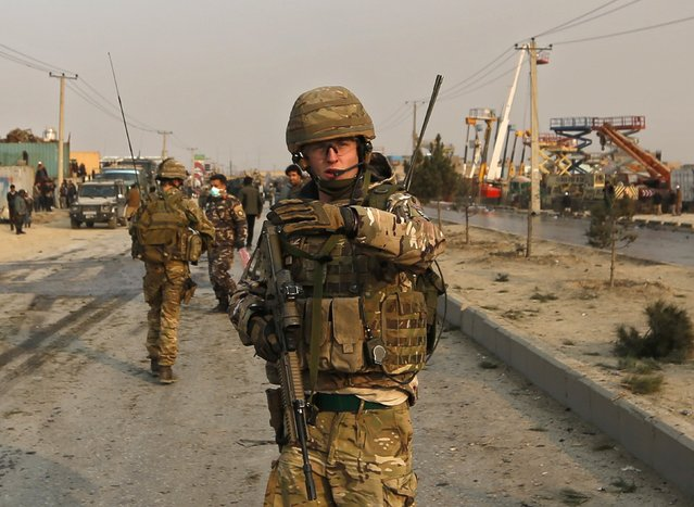 British soldiers block the road at the site of a suicide attack in Kabul January 5, 2015. (Photo by Mohammad Ismail/Reuters)