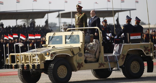 Iraqi Prime Minister Haider al-Abadi takes part in the Iraqi Army Day anniversary celebration in Baghdad January 6, 2015. (Photo by Thaier al-Sudani/Reuters)