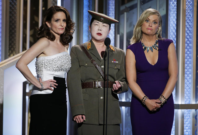 In this handout photo provided by NBCUniversal, Tina Fey,  Margaret Cho and  Amy Poehler speak onstage during the 72nd Annual Golden Globe Awards at The Beverly Hilton Hotel on January 11, 2015 in Beverly Hills, California. (Photo by Paul Drinkwater/NBCUniversal via Getty Images)