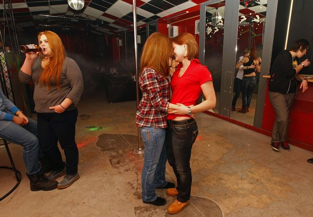 """People dance at a private gay club called """"Malevich"""" in St. Petersburg February 2, 2013. (Photo by Alexander Demianchuk/Reuters)"""