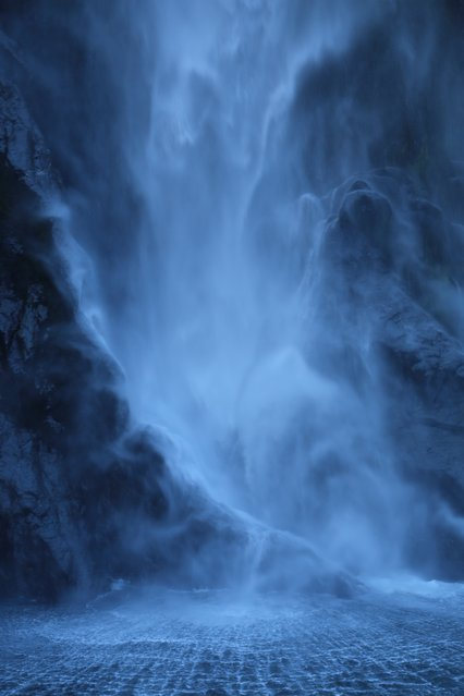 """Ghostly Waterfall – Stirling Falls, Milford Sound, New Zealand (April 2013)"". This photo was taken from a boat of Stirling Falls at Milford Sound in New Zealand in April 2013. Lord of the Rings territory!! I used a Canon 5D Mark III using a Canon EF 24-105mm f/4L IS lens and a polarizer. Details: f/5.6, 1/60, ISO 250, 0.7 EV, 50mm. Have you ever been right in front of a huge waterfall? It's ethereal and ghostly and I feel (and hope!) that this image captures that feeling. I couldn't use a tripod on the moving boat, but got exactly the shot I wanted. (Photo and caption by Charlotte Ralph/National Geographic Traveler Photo Contest)"