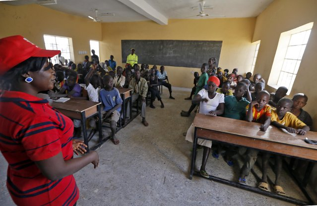 Children displaced as a result of Boko Haram attacks in the northeast region of Nigeria, attend class at Maikohi secondary school inside a camp for internally displaced persons (IDP) in Yola, Adamawa State January 13, 2015. (Photo by Afolabi Sotunde/Reuters)