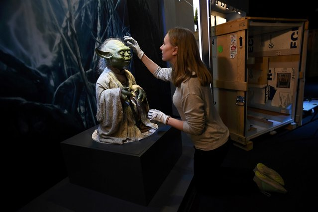 Lucas Museum of Narrative Art (LMNA) registrar Nicole Manis, from San Francisco, helps unpack the Yoda puppet used in the original movies, at the Star Wars Identities exhibition at the 02 in London, Britain, November 8, 2016. (Photo by Dylan Martinez/Reuters)