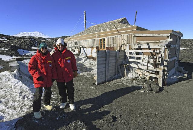 U.S. Secretary of State John Kerry, right, and scientist Kelly Falkner outside the historic Shackleton hut near McMurdo Station, Antarctica, Friday, November 11, 2016. (Photo by Mark Ralston/Pool Photo via AP Photo)
