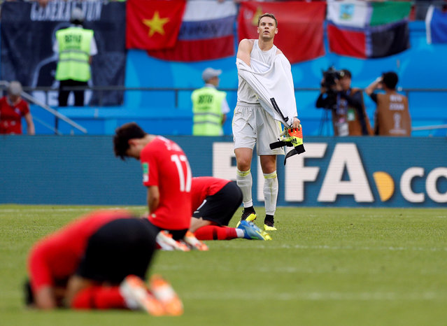 Germany's Manuel Neuer looks dejected after the Russia 2018 World Cup Group F football match between South Korea and Germany at the Kazan Arena in Kazan on June 27, 2018, as they go out of the World Cup. (Photo by John Sibley/Reuters)