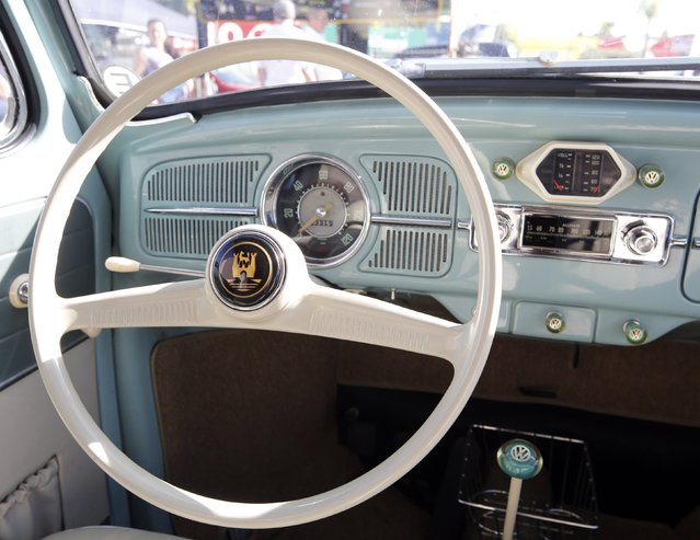 The steering wheel, speedometer and fuel gauge of a 1959 Volkswagen beetle are seen during a Volkswagen Beetle owners' meeting in Sao Bernardo do Campo January 25, 2015. (Photo by Paulo Whitaker/Reuters)