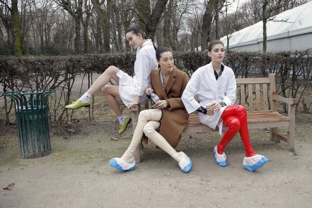 Models take a rest backstage after the Christian Dior's Spring-Summer 2015 Haute Couture fashion collection presented in Paris, France, Monday, January 26, 2015. (Photo by Francois Mori/AP Photo)