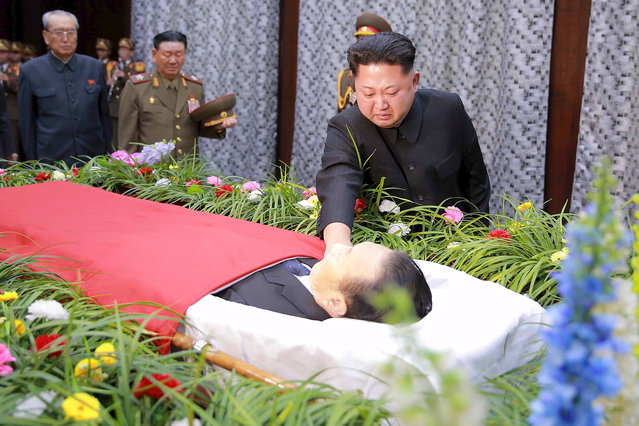 North Korean leader Kim Jong Un reacts as he pays his last respects to Kim Yang Gon in this undated photo released by North Korea's Korean Central News Agency (KCNA) in Pyongyang December 31, 2015. Kim Yang Gon, a senior North Korean official and a top aide to leader Kim Jong Un died in a car accident, state news agency reported on Wednesday, the latest dramatic death or disappearance in the close circle of deputies to the country's leader. (Photo by Reuters/KCNA)