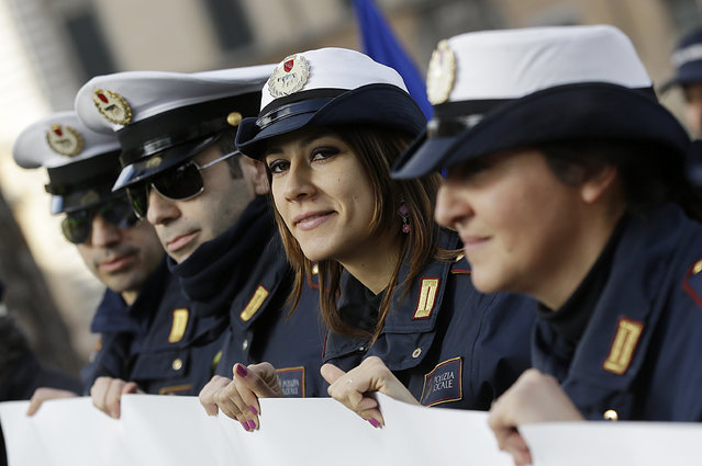 Italian municipal police officers gather during a demonstration asking to change the laws governing their contracts in Rome, Thursday, February 12, 2015. (Photo by Gregorio Borgia/AP Photo)