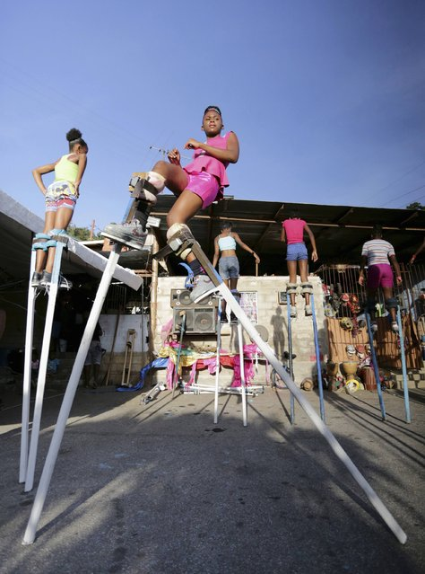 Members of the Keylemanjahro School of Art and Culture practise dancing moves on stilts in the base yard at Harding Place, Cocorite, just West of the capital of Port-of-Spain, Trinidad, on February 8, 2015. (Photo by Andrea De Silva/Reuters)