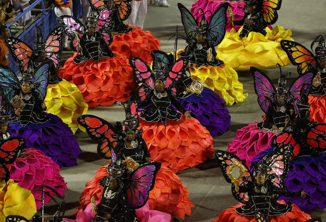 Performers from the Uniao da Ilha samba school parade during carnival celebrations at the Sambadrome in Rio de Janeiro, Brazil, Tuesday, February 17, 2015. (Photo by Leo Correa/AP Photo)