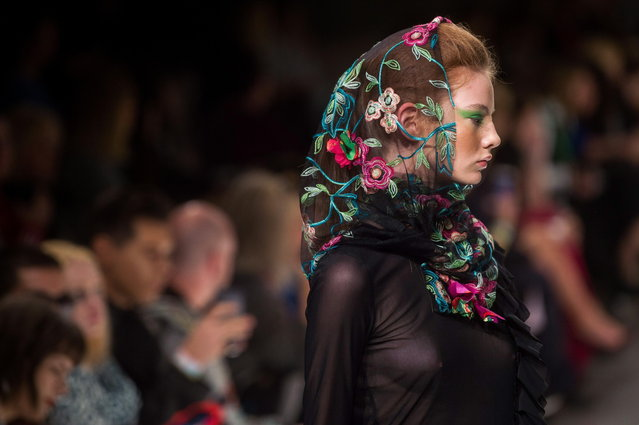 A model sports a creation by the Hungarian label Romani Design during a show of the second bi-annual Budapest Central European Fashion Week in Budapest, Hungary, 26 October 2018. (Photo by Zoltan Balogh/EPA/EFE)