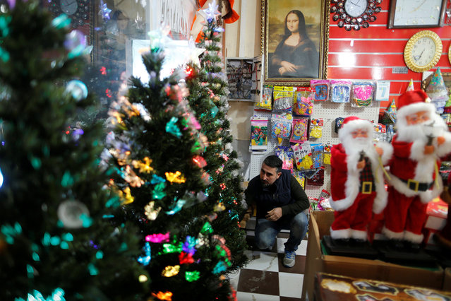 A shop owner for Christmas decorations waits for customers at a market in the northern Iraqi city of Erbil, December 23, 2016. (Photo by Ammar Awad/Reuters)