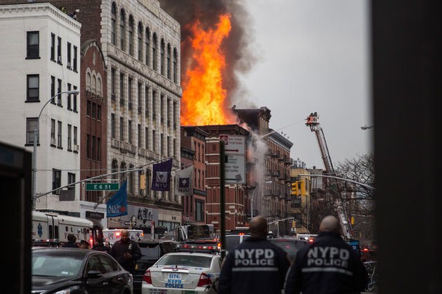 A building burns after an explosion on 2nd Avenue on March 26, 2015 in New York City. The seven alarm fire drew firefighters from across the city. A number of injuries have been reported. (Photo by Andrew Burton/Getty Images)