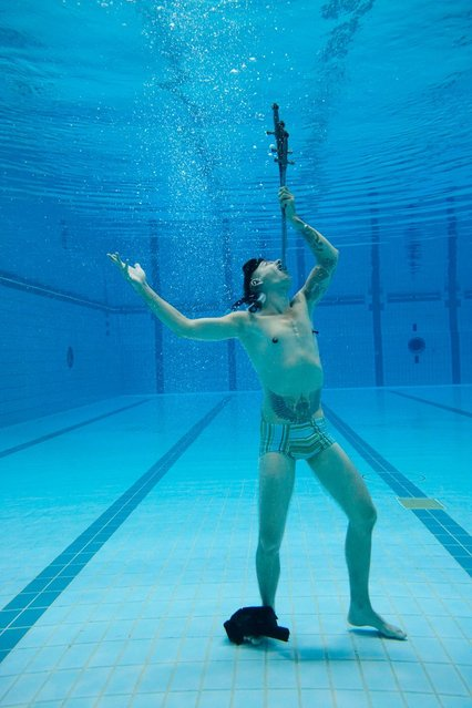 Chayne Hultgren, at Sydney Olympic Park Aquatic Centre, Australia, who set a record by swallowing three swords underwater during the ninth annual Guinness World Records Day, the international day of record breaking. (Photo by PA Wire)