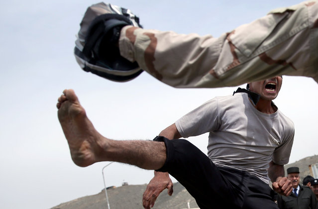Afghanistan's interior ministry special forces demonstrate their skills during a military exercise in Kabul, Afghanistan, Thursday, April 2, 2015. (Photo by Massoud Hossaini/AP Photo)