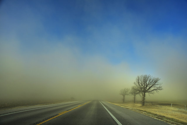 Dirt and dust blows across a field Monday, February 8, 2016 in Stafford, Kan. (Photo by Andrew Whitaker/The Hutchinson News via AP Photo)
