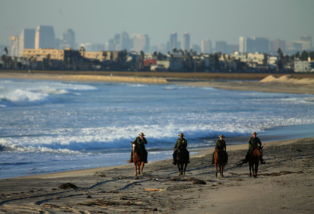 U.S. Border Patrol agents on horseback patrol along a beach just north of the U.S.-Mexico border near San Diego, California, U.S., November 10, 2016. (Photo by Mike Blake/Reuters)