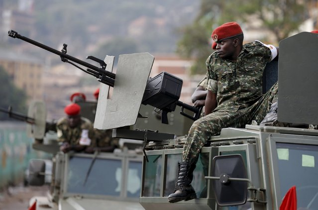 An Ugandan soldier rests on top of an armoured vehicle in Kampala, Uganda February 20, 2016. (Photo by Goran Tomasevic/Reuters)